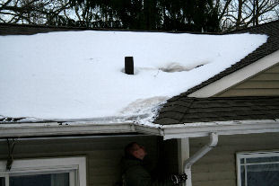 roof ice dam caused by simple bathroom exhaust